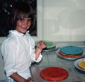 Here's seven-year-old Lisa, helping with her birthday layer cake!
